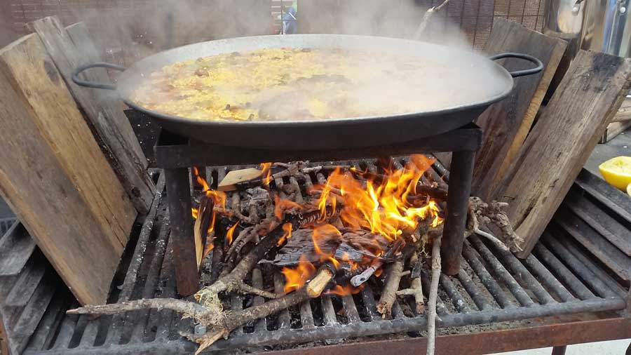 cooking spanish paella in barbecue